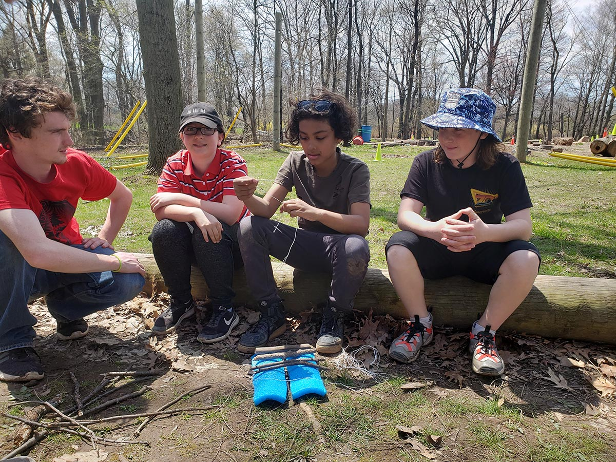 Students build a campfire